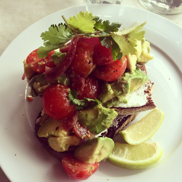 Avocado, cherry tomatoes, lime and goats cheese on rye.