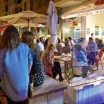 People drinking wine and tapas in a bar. Pintxo pote. Gros quarter. Donostia. San Sebastian. Gipuzkoa. Basque Country. Spain.